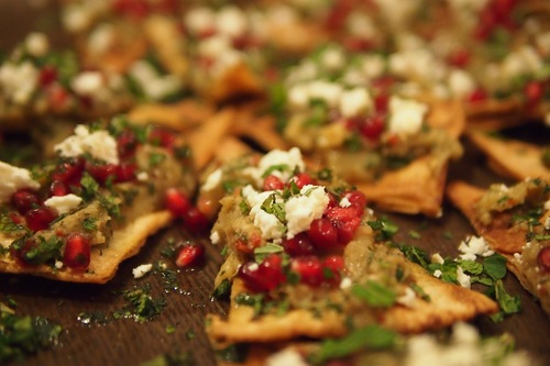 Smoked aubergine with feta, chill & mint on baked sea salt & cumin pitta crisps